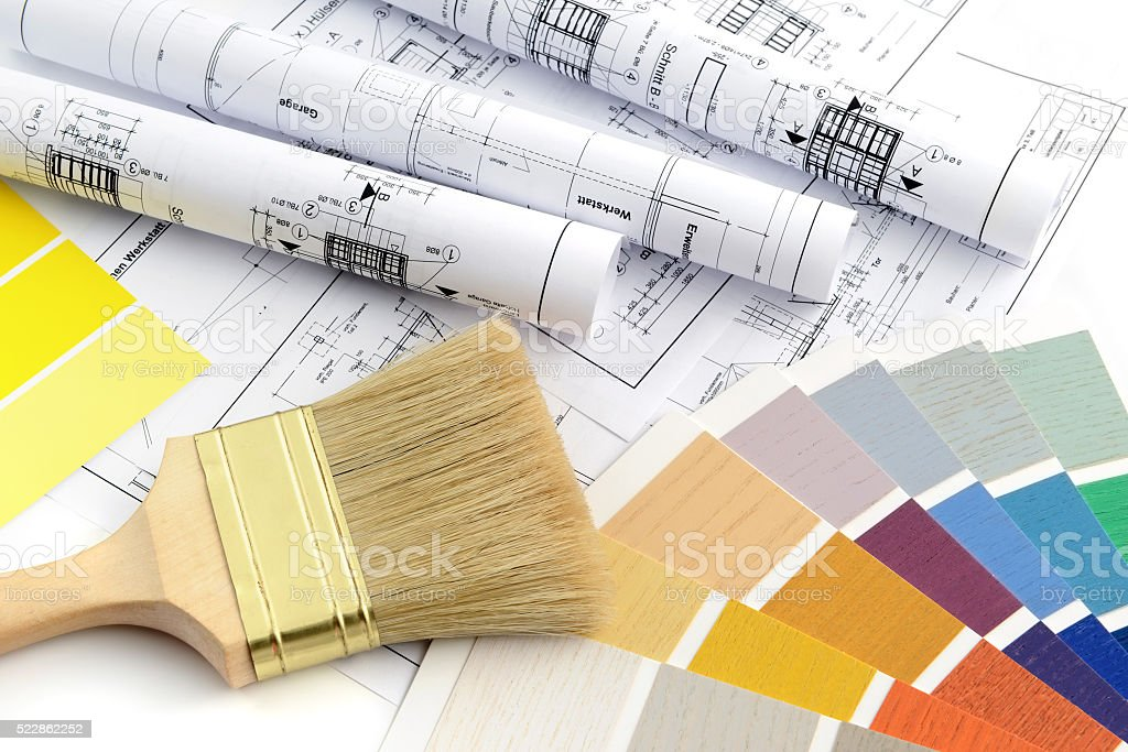 rolls of blueprints with paintbrush and color swatch stock photo