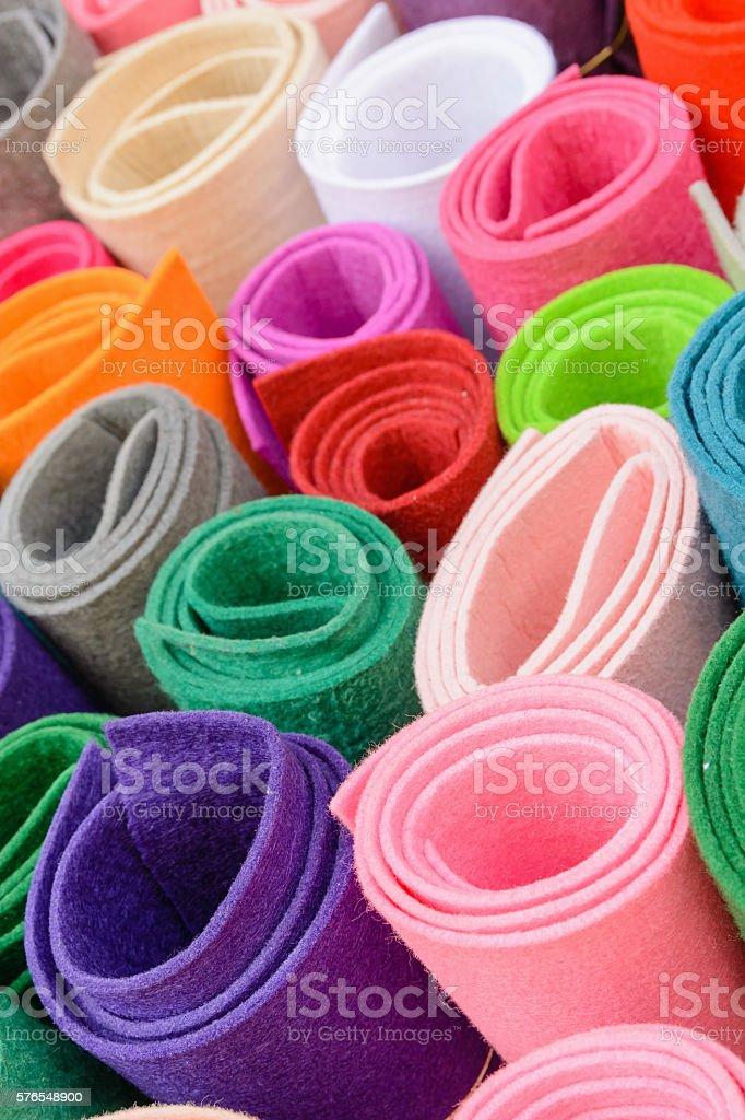 Rolls of colored fabrics. Color felt bright colors. stock photo