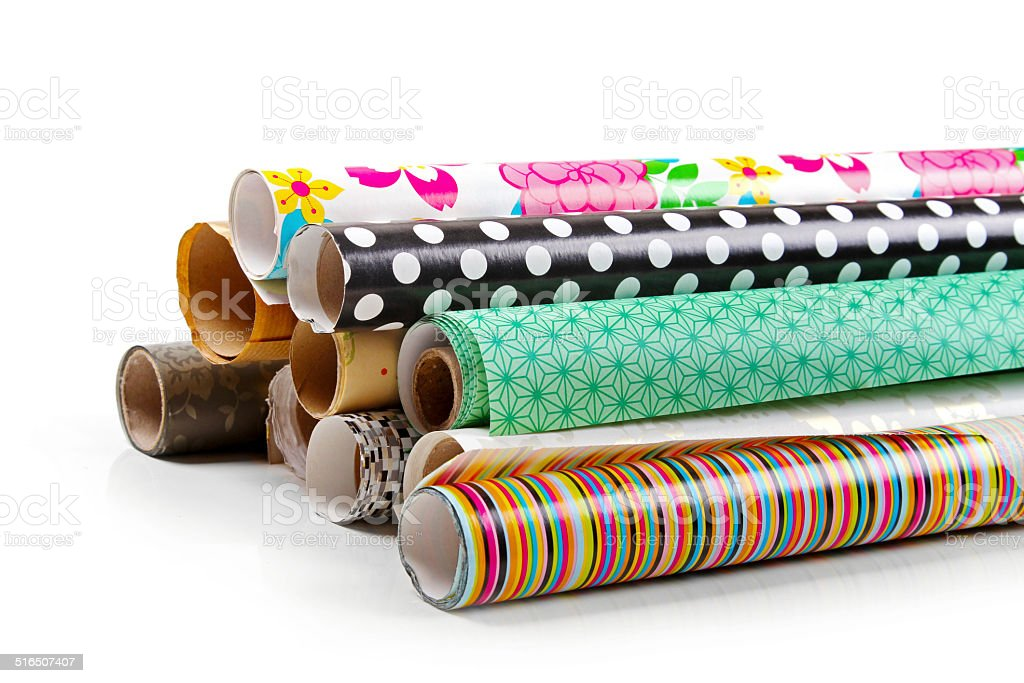 rolls of colorful wrapping paper isolated on white stock photo
