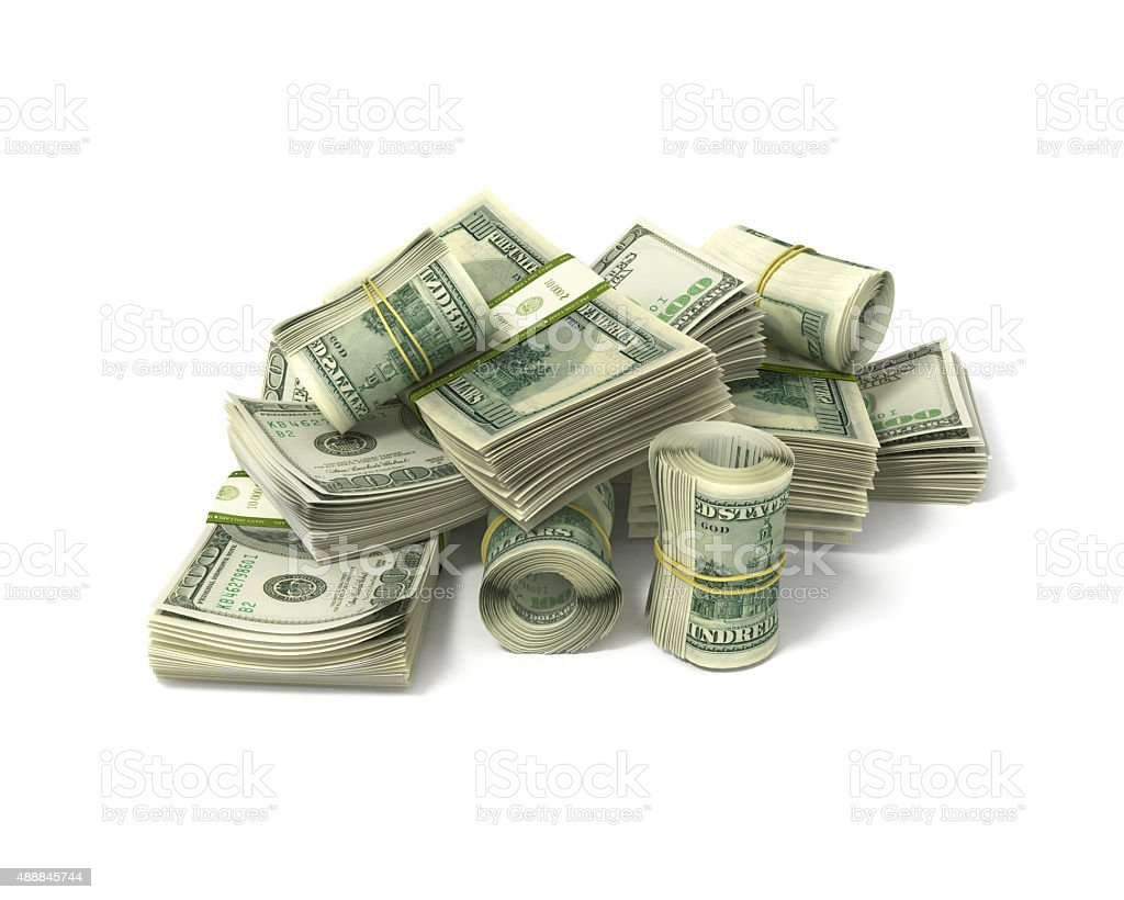 rolls of dollars and stacks of bills isolated on white stock photo