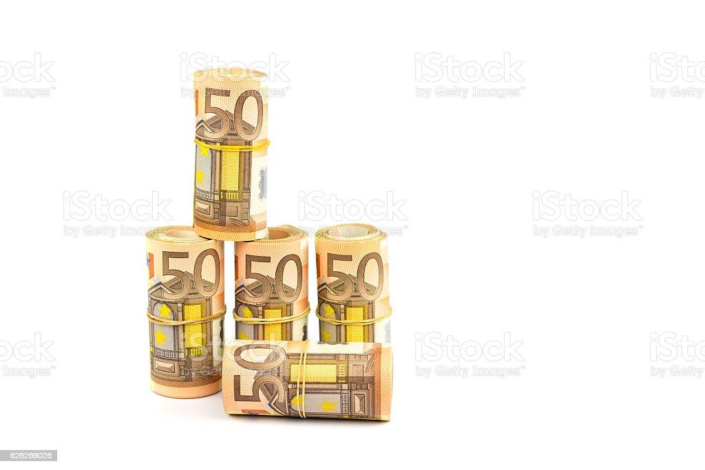 Rolls of euro notes isolated on white background stock photo