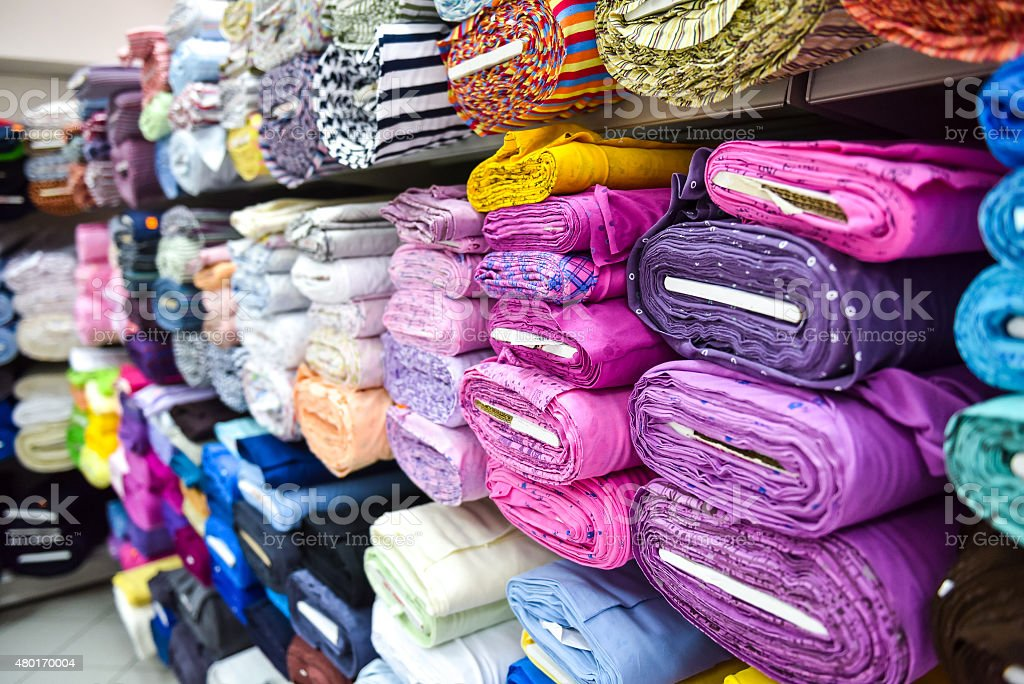 Rolls of fabri and textiles in a factpory shop. stock photo