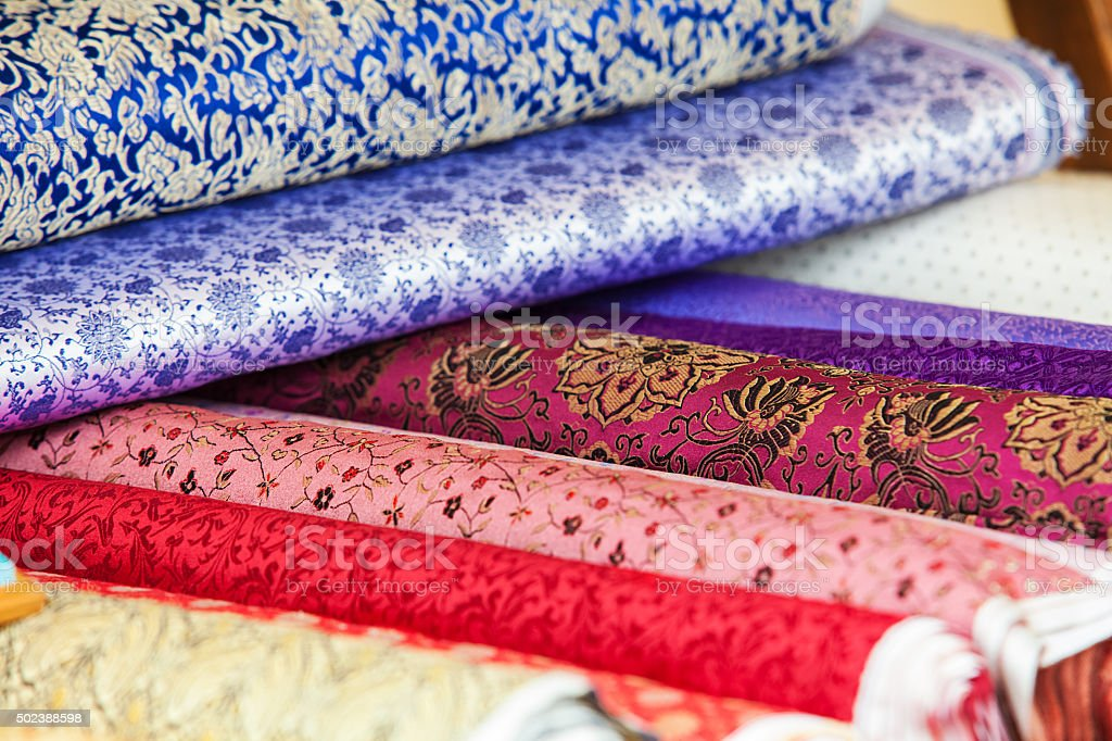 Rolls of fabric and textiles in a factory shop stock photo