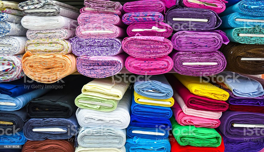 Rolls of fabric and textiles in a factpory shop. stock photo