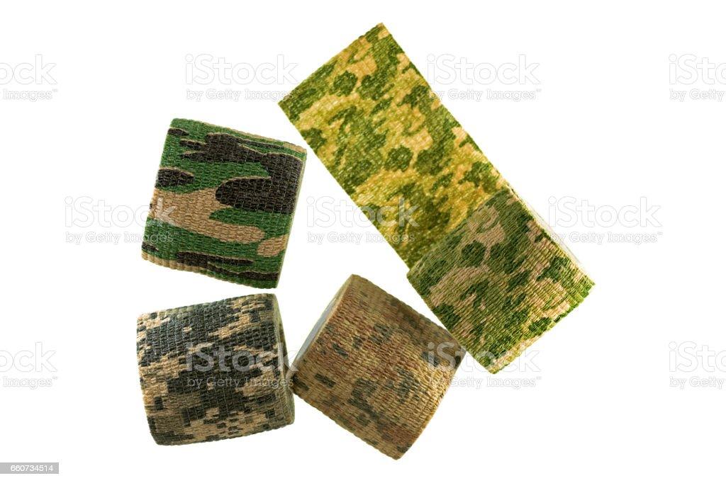 Rolls of fabric camouflage pattern stretchable bandage tape isolated on white background stock photo