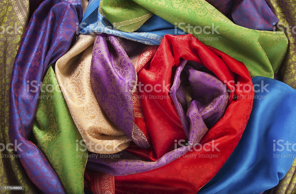 Rolls of fabrics on the table royalty-free stock photo