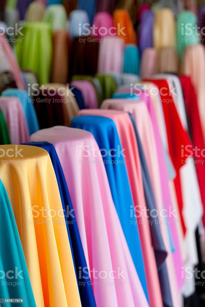 Rolls of multicoloured satin textiles. royalty-free stock photo