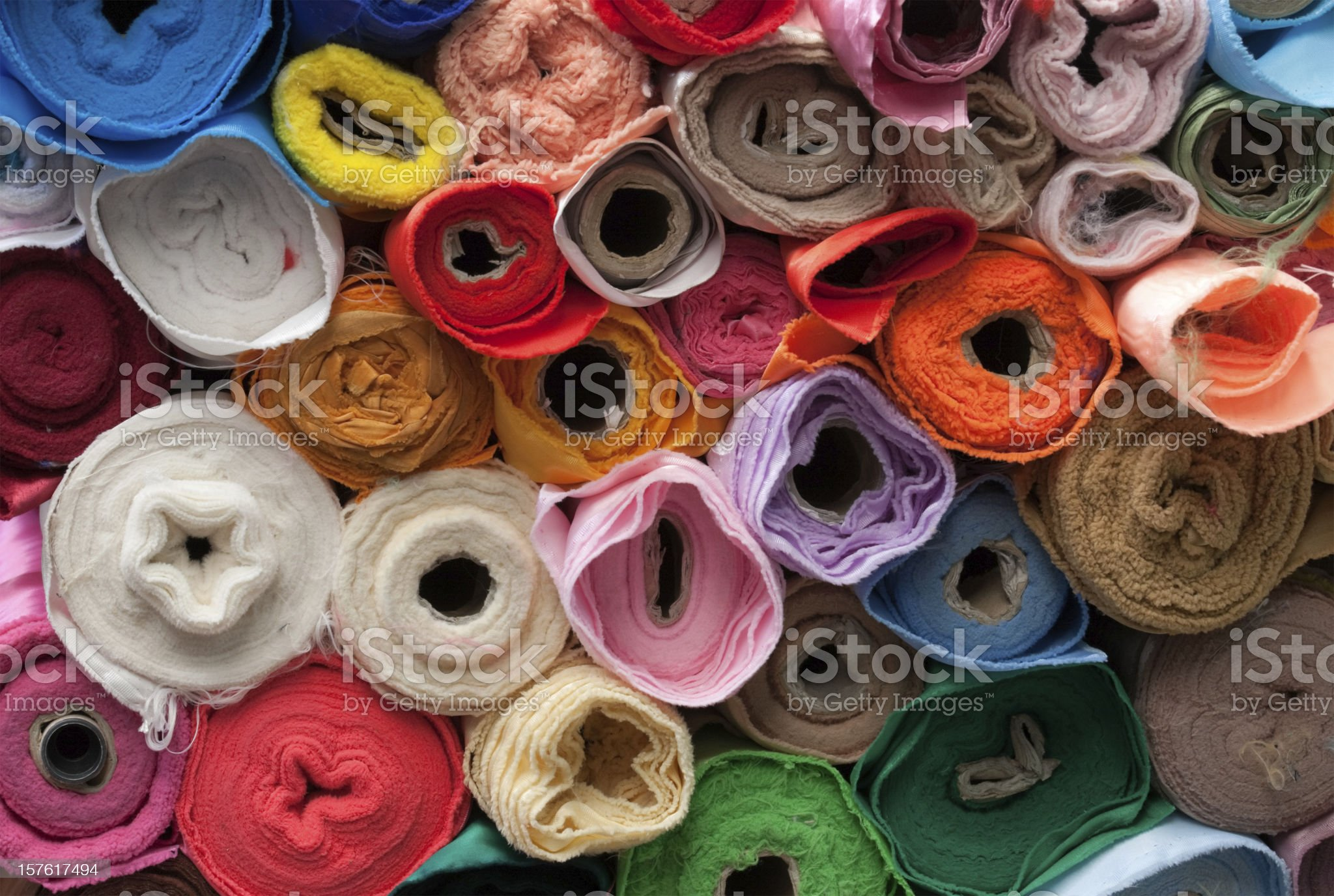 Rolls of multicoloured textiles. royalty-free stock photo