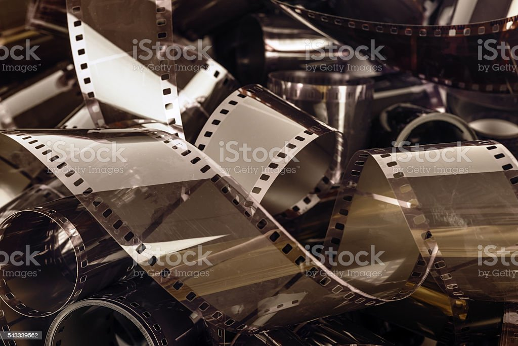 rolls of negative celluloid films - 35mm stock photo