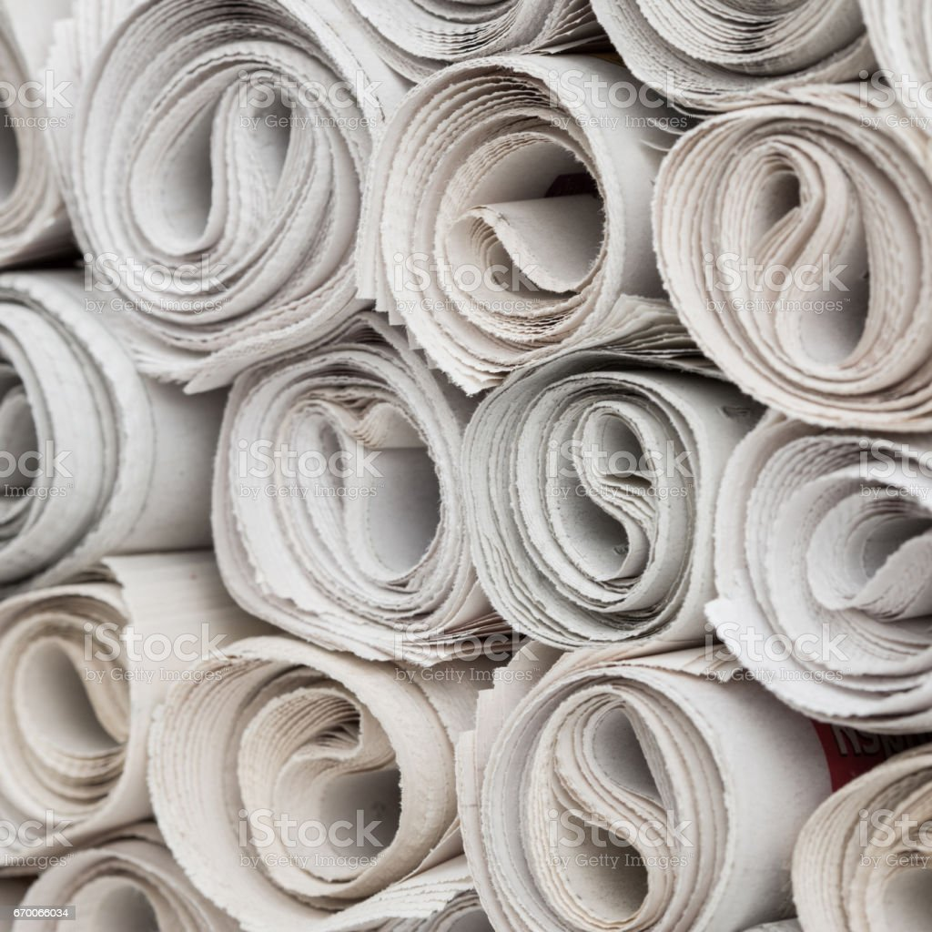 Rolls of newspapers stock photo
