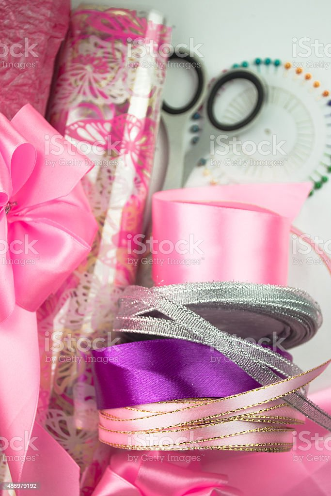 Rolls of pink wrapping paper. Materials  for wrapping gifts stock photo