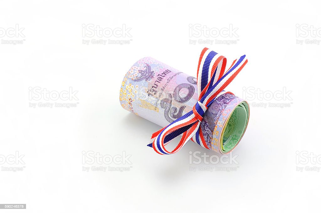 Rolls of Thai Bath, banknotes on white background stock photo
