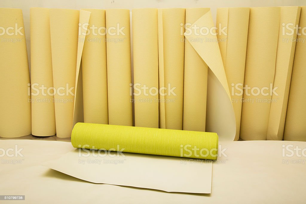 Rolls of wallpaper of two colors ready for applying stock photo