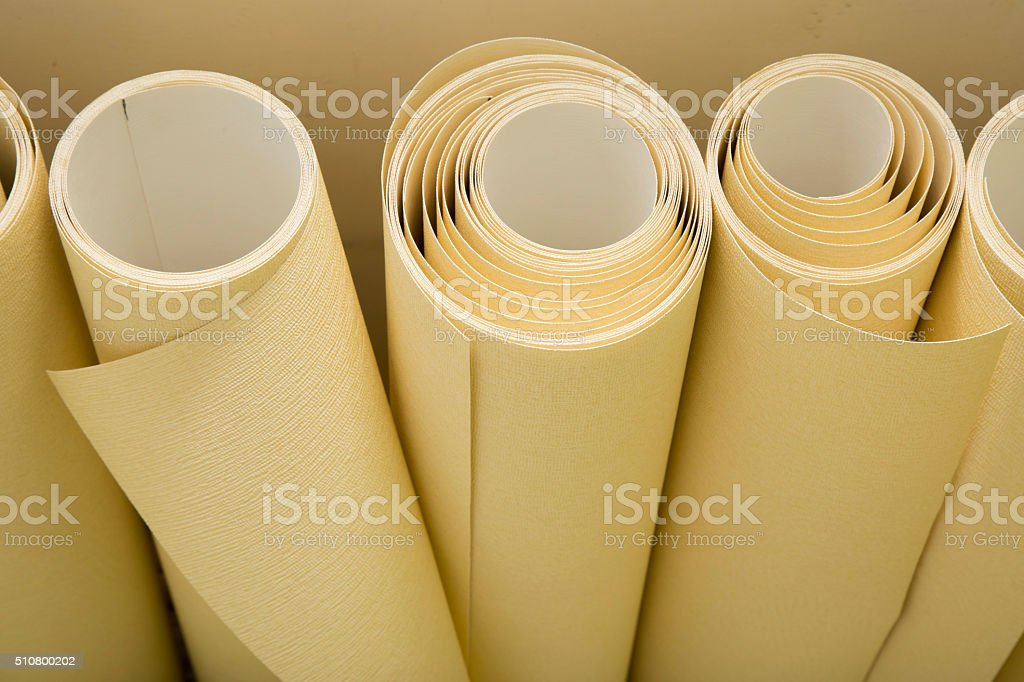 Rolls of wallpaper ready for applying stock photo