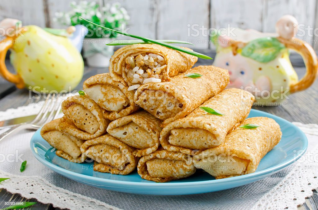 Rolls pancakes stuffed with meat and rice stock photo