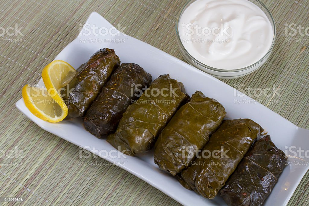 Rolls stuffed vine leaves with meat stock photo