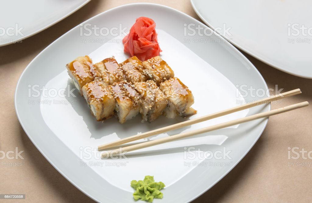 rolls with eel and ginger on a white plate stock photo