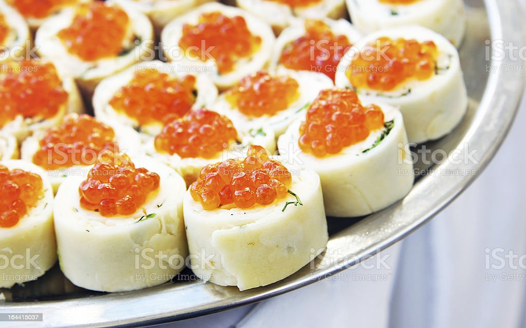 Rolls with salmon roe on a dish royalty-free stock photo