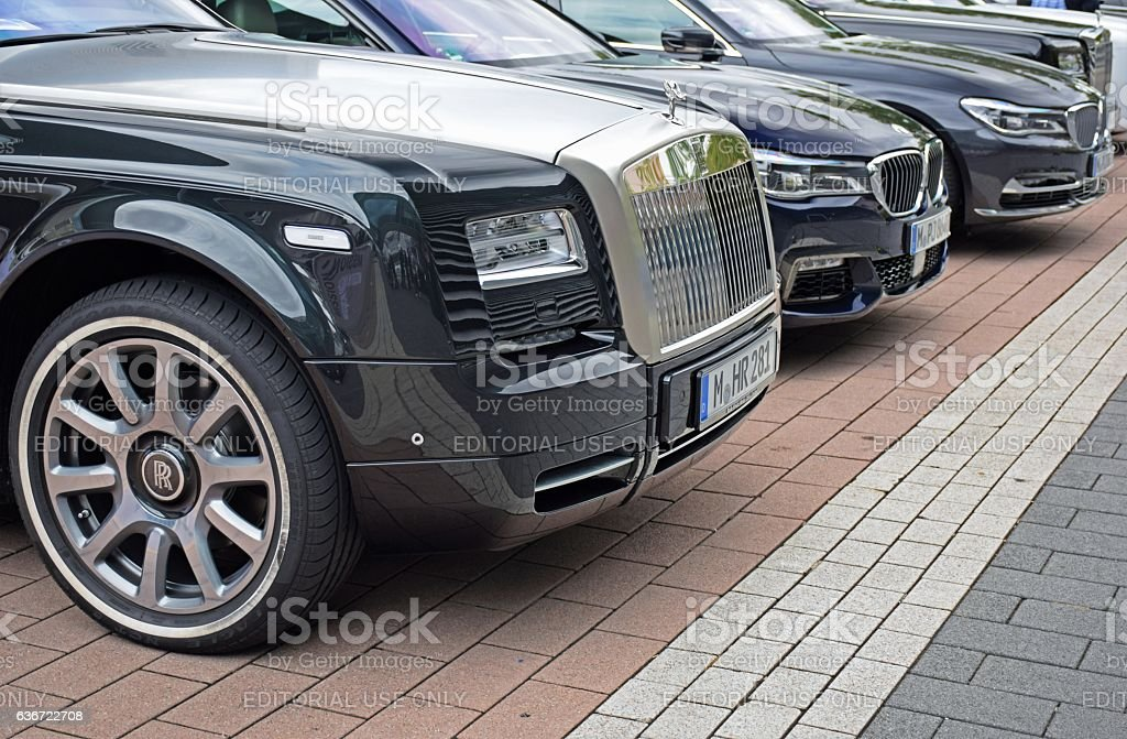Rolls-Royce and BMW vehicles on the parking stock photo