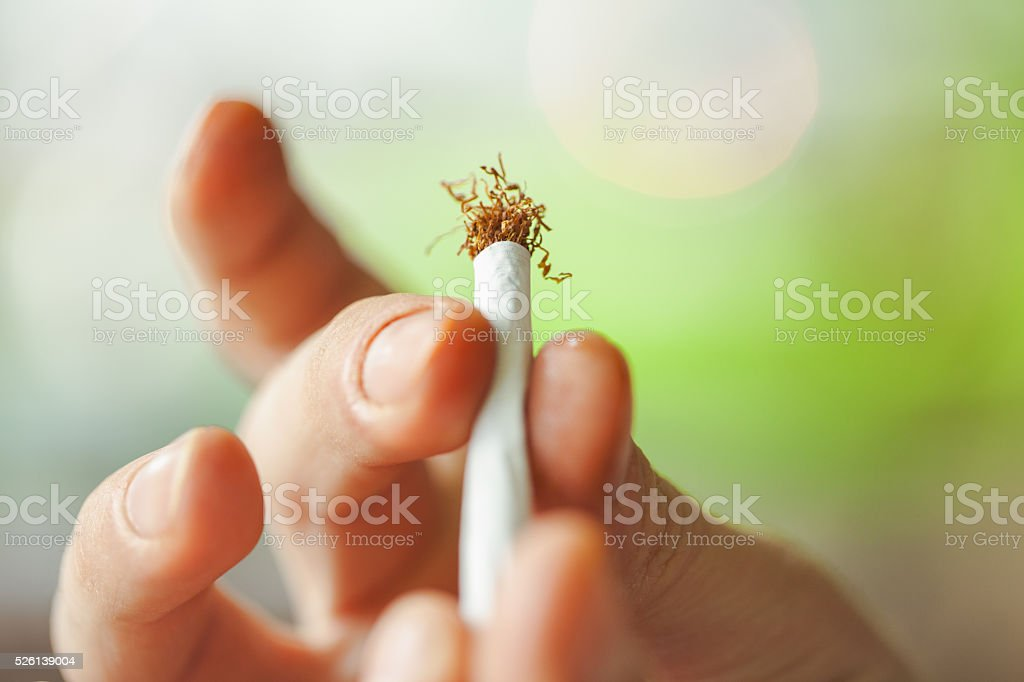 Roll-up cigarette close-up stock photo