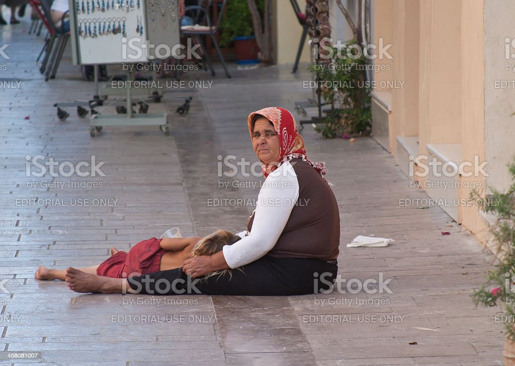 Roma Gypsy Woman Using Child For Profit royalty-free stock photo