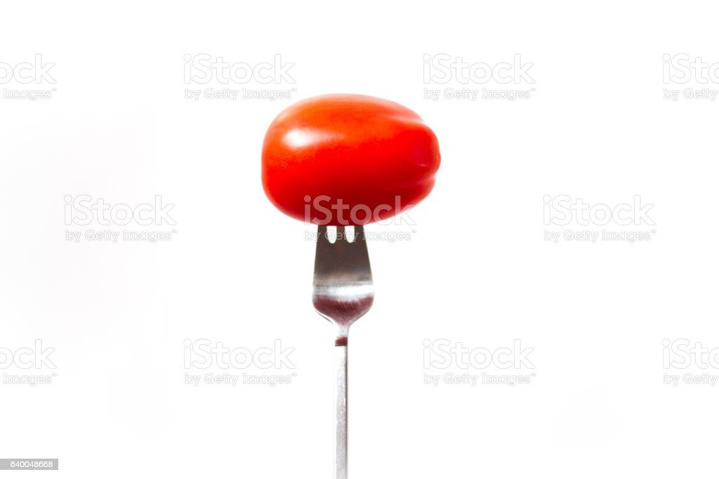 Roma Tomato on a Fork, White Background stock photo