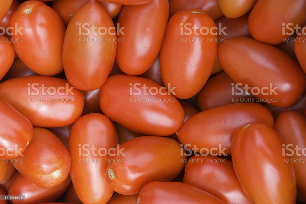 Roma Tomato Stack Background in Farmers Market royalty-free stock photo