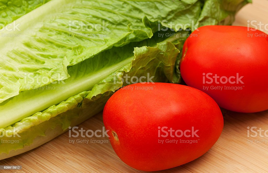 Romaine Lettuce and Roma Tomatoes stock photo