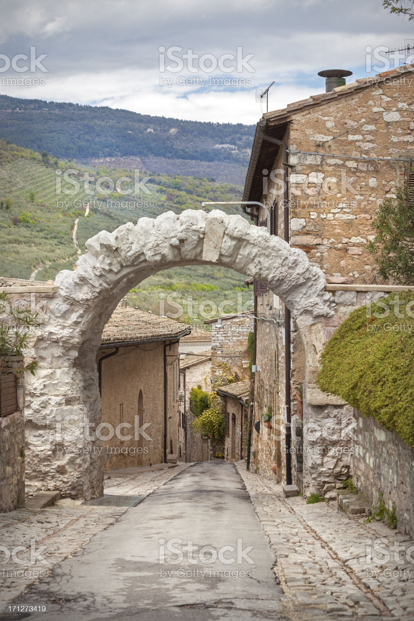 Roman arch in Spello, Umbria Italy royalty-free stock photo