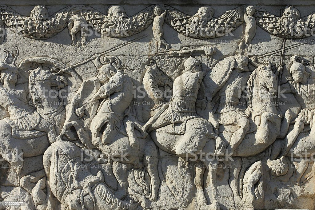 Roman bas-relief with knights stock photo