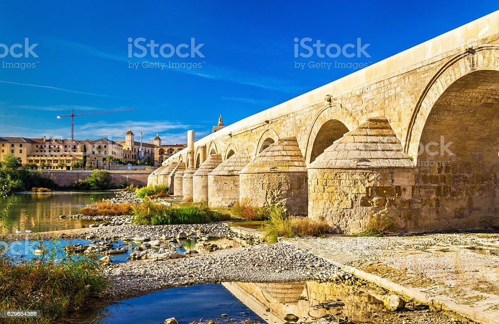 Roman Bridge above the Guadalquivir river in Cordoba, Spain stock photo
