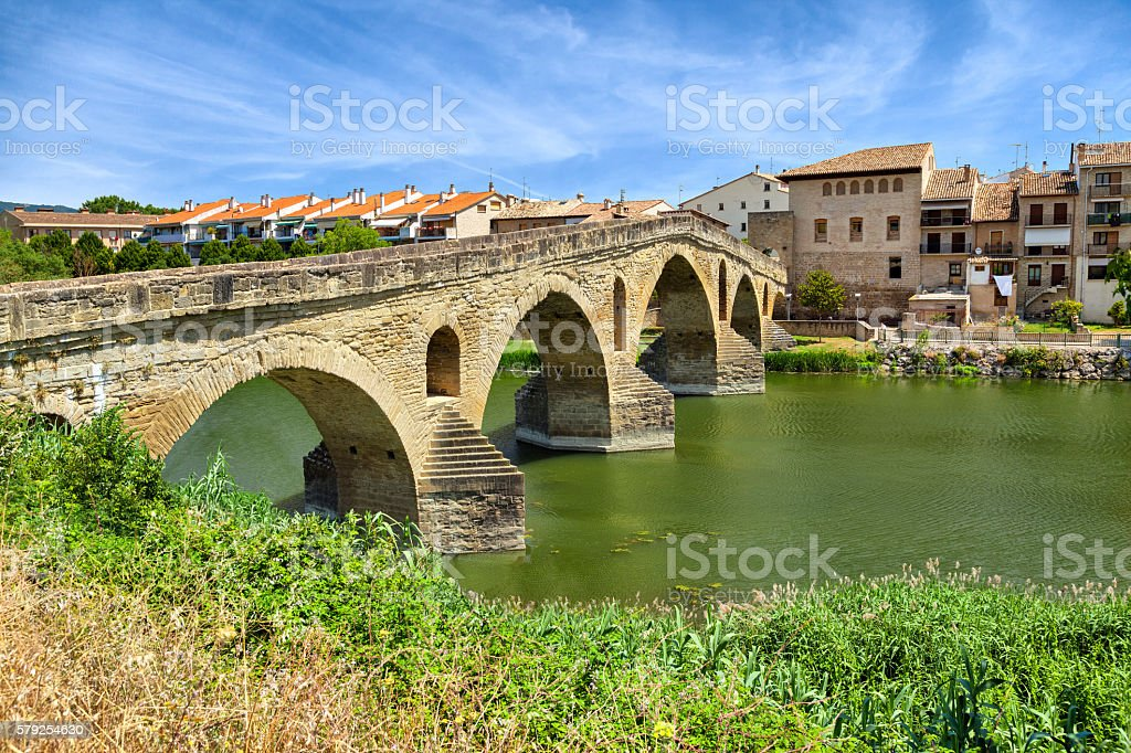 Roman bridge across the Arga river in Puente la Reina stock photo
