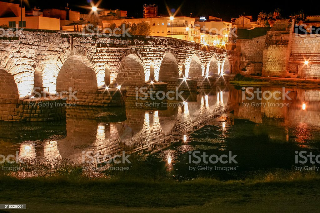 Roman bridge and alcazaba at night, Merida, Spain stock photo