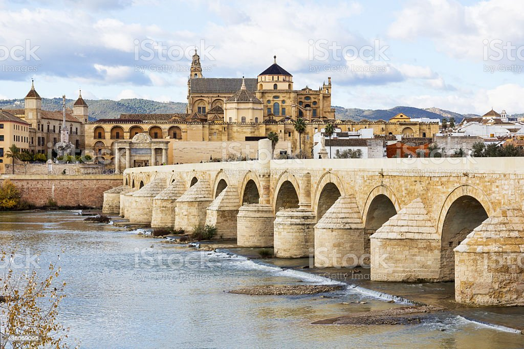 Roman Bridge and Mosque Cathedral of Cordoba in Spain stock photo