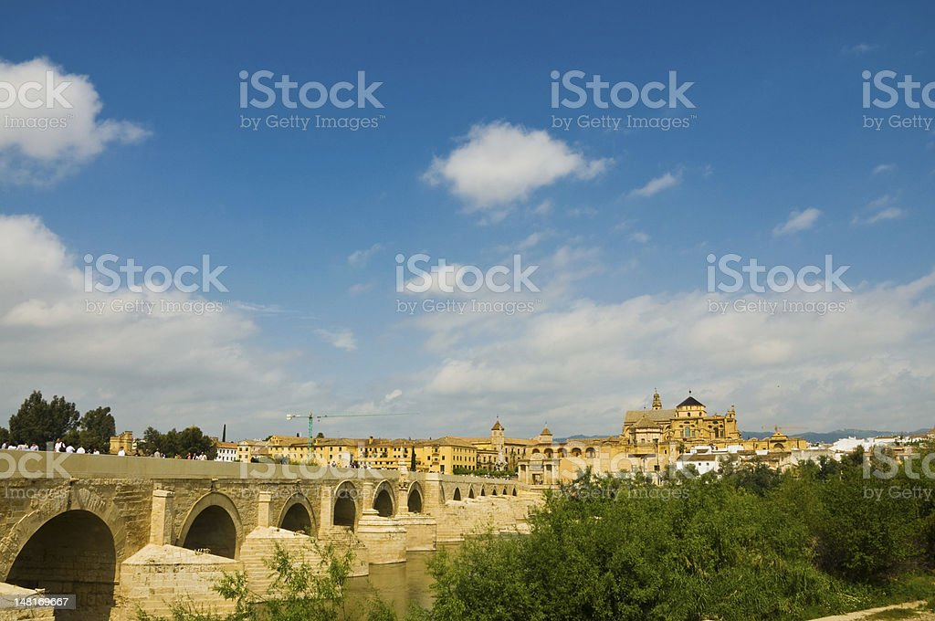 Roman bridge of cordoba leading to Mezquita royalty-free stock photo