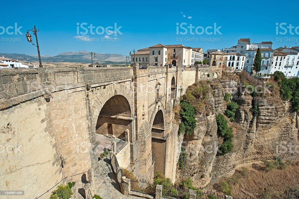 Roman bridge over a canyon under a blue sky stock photo
