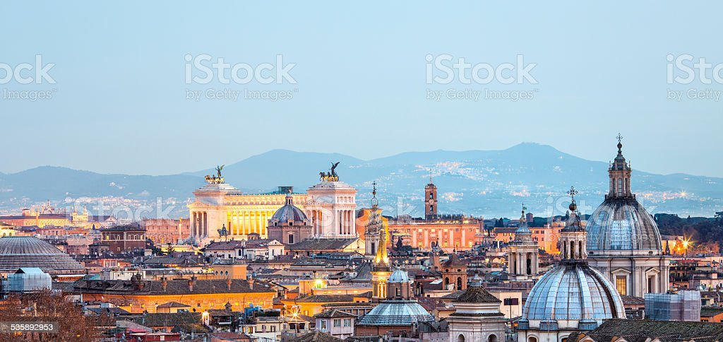 Roman citscape panorama at sunset in January, Rome Italy stock photo