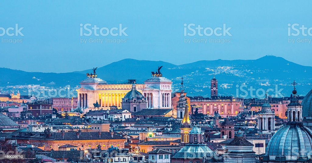 Roman citscape panorama at night in January, Rome Italy stock photo
