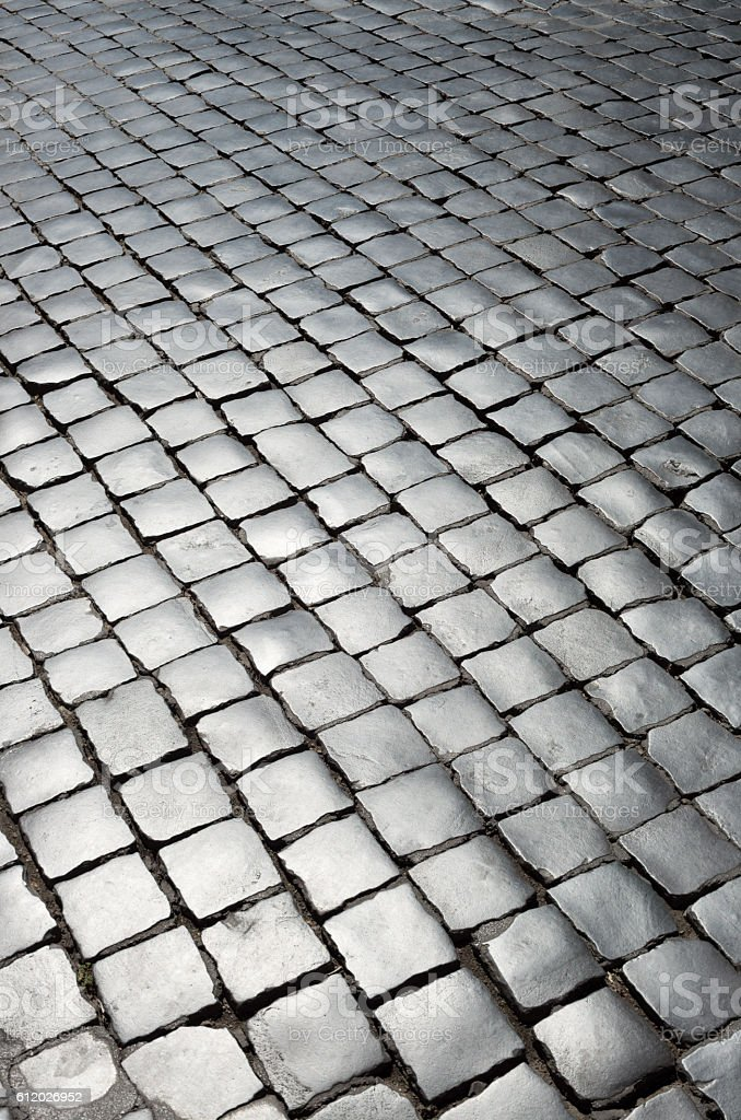 Roman cobblestone background with tilted pattern, Roma Italy stock photo