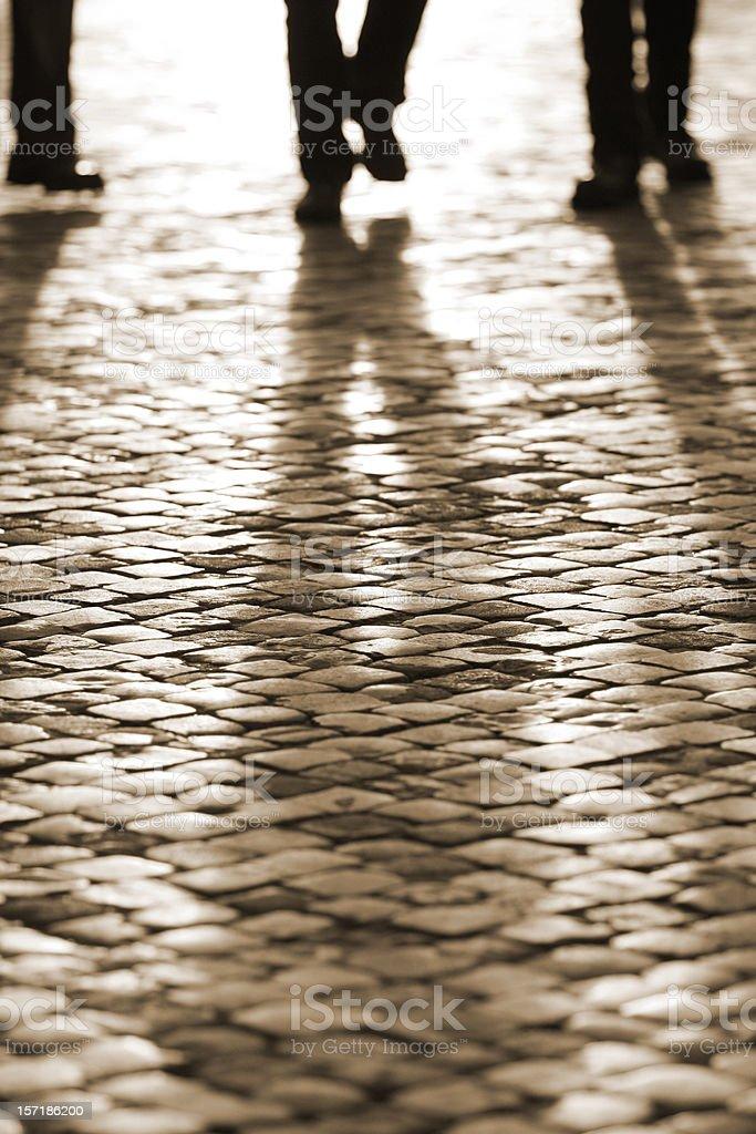 Roman cobblestone leg silhouette, Rome Italy stock photo