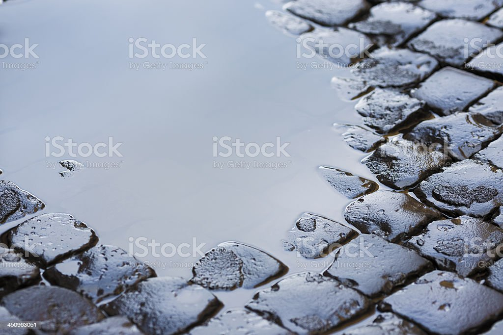 Roman cobblestone with puddle, Rome Italy stock photo