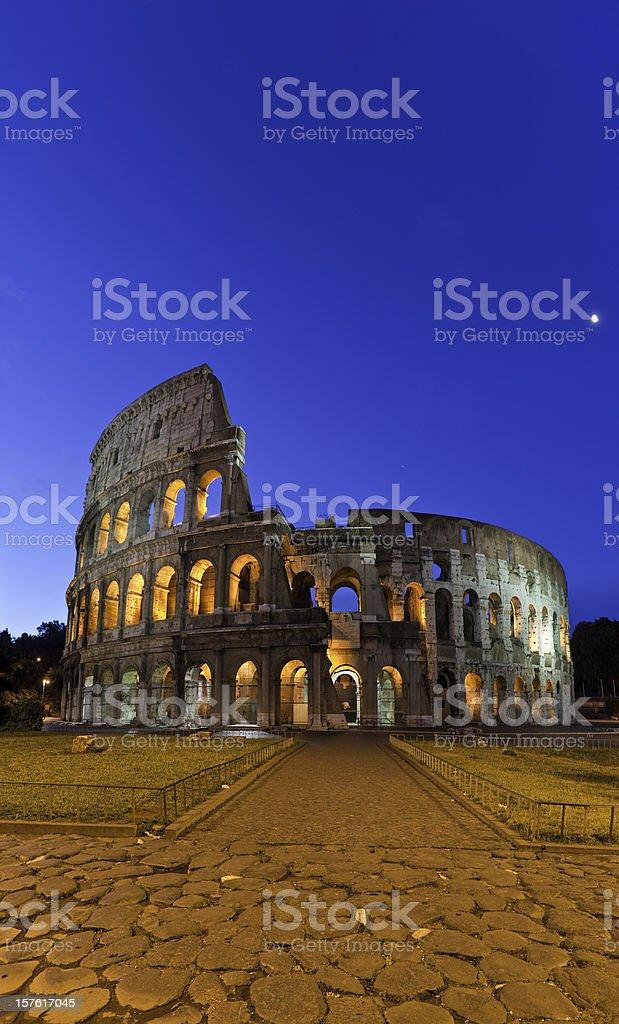 Roman Coliseum ancient amphitheatre iconic landmark vertical panorama Rome Italy stock photo