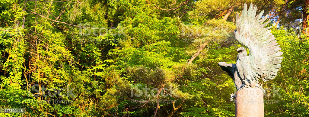 Roman eagle statue in Japanese forest panorama stock photo