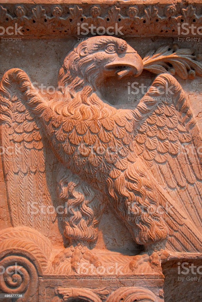 Roman eagle with olive branch stock photo