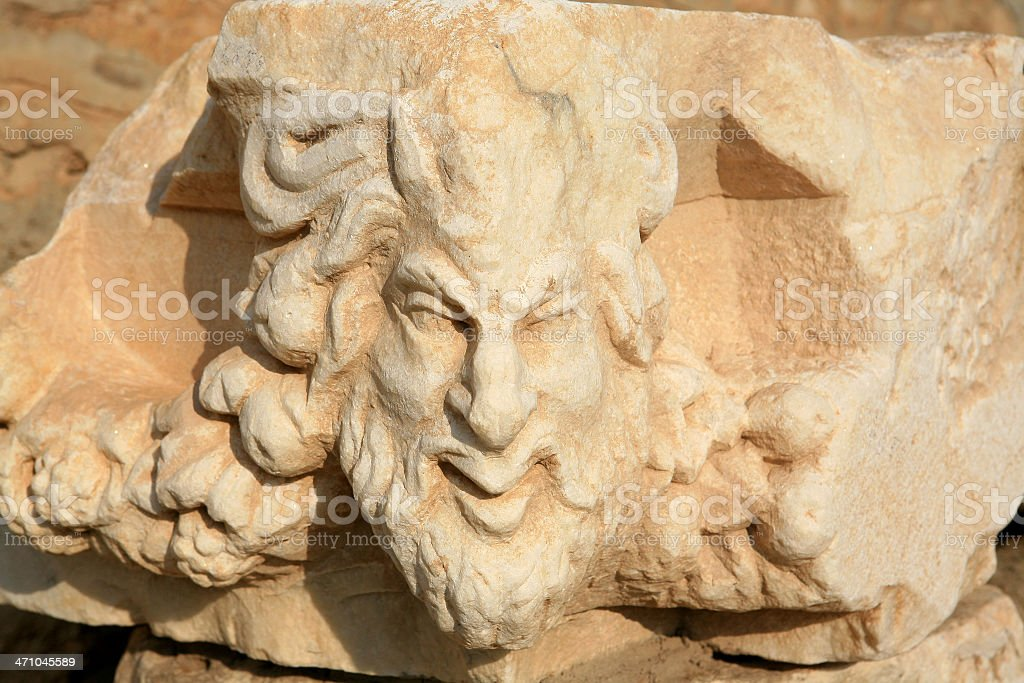 Roman face from a stone frieze at Aprodisias royalty-free stock photo