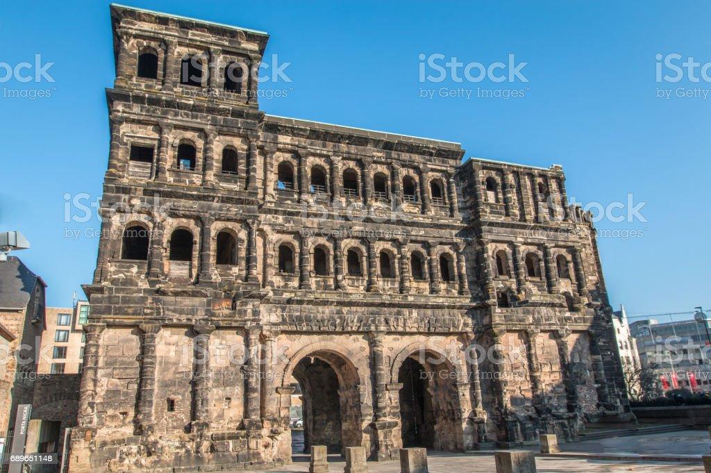 Roman gate ruin in Trier stock photo