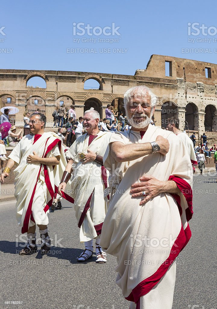 Roman man in toga greeting - historical parade, Rome Italy stock photo