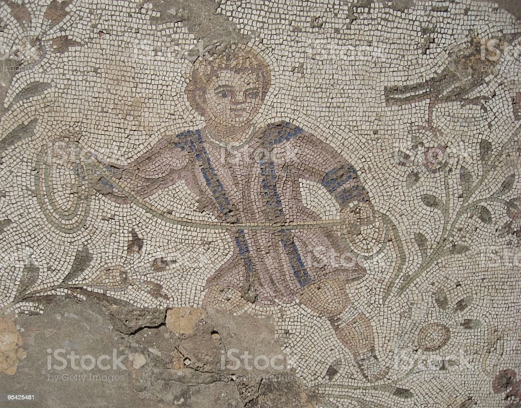 Roman Mosaic Depicting a Boy Catching Birds, Carthage, Tunisia stock photo