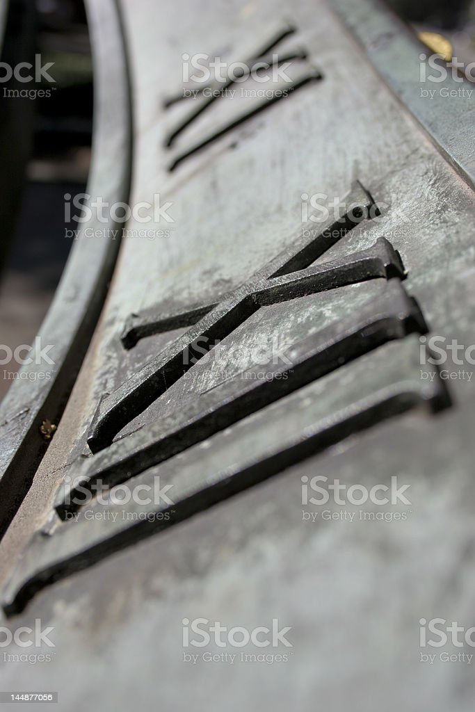 Roman Numeral XII and XI royalty-free stock photo