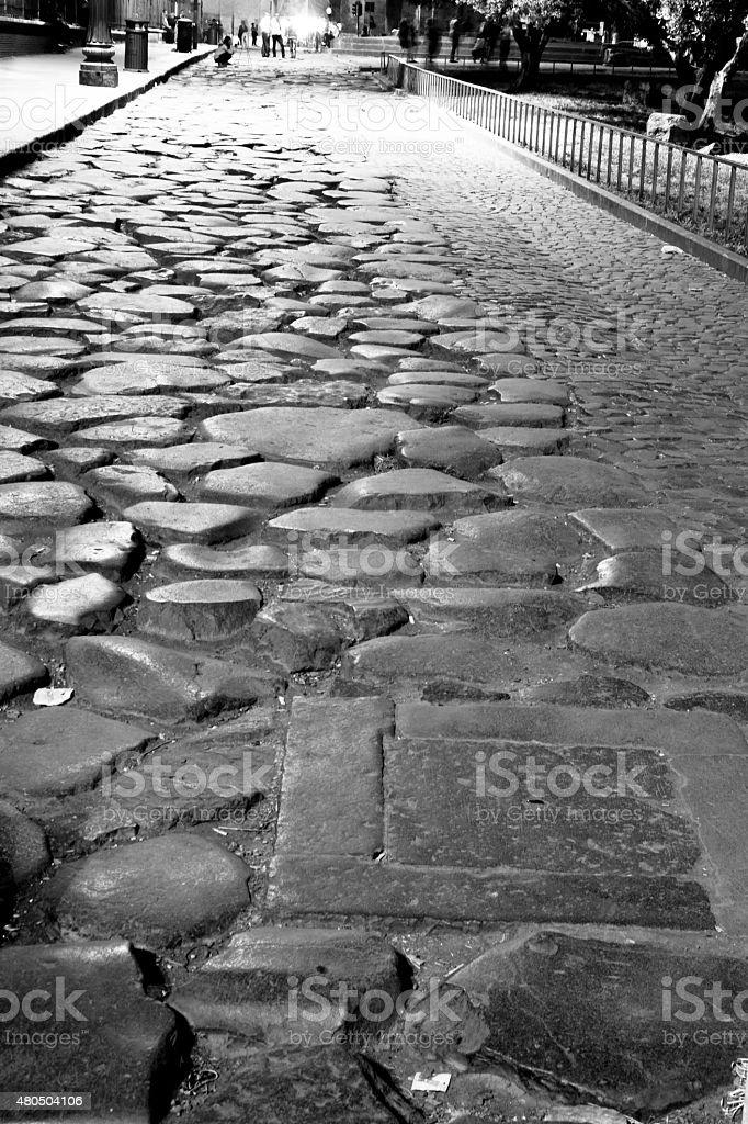 Roman road with cobblestones stock photo